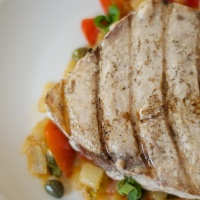 Grilled Swordfish Over Tomato & Caper Sauté