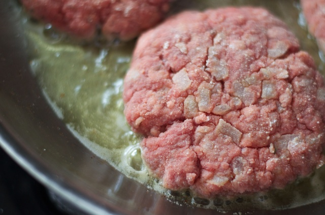burgers cooking in ghee coconut oil