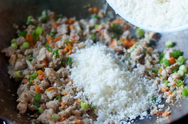 adding cauliflower to paleo fried rice