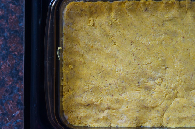dough pressed into baking dish